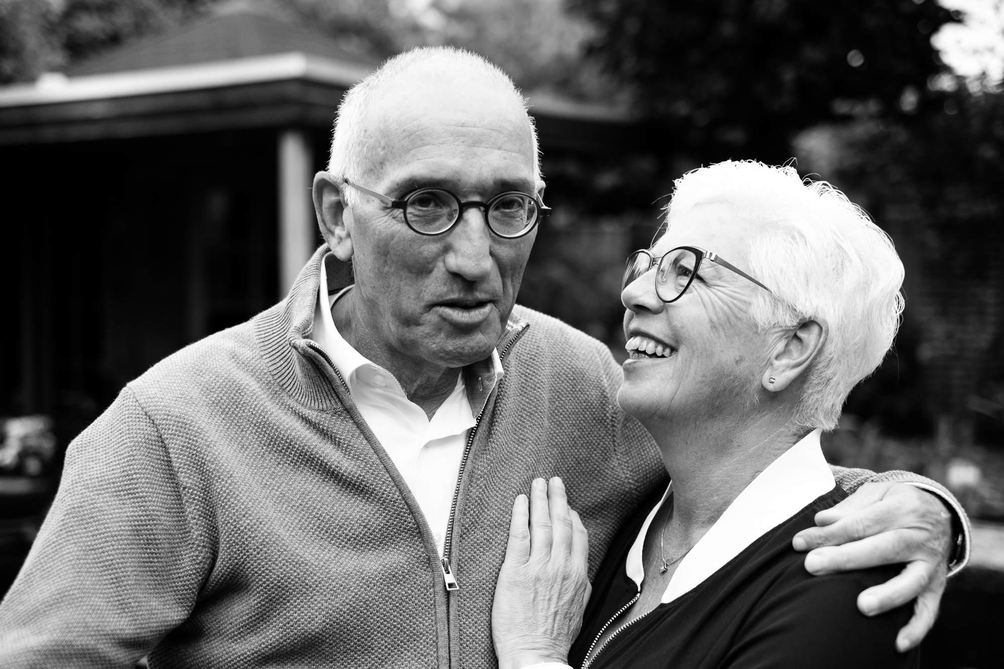 An elderly couple still looking in love