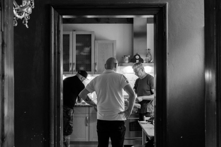 Three friends cooking together after the first corona lockdown