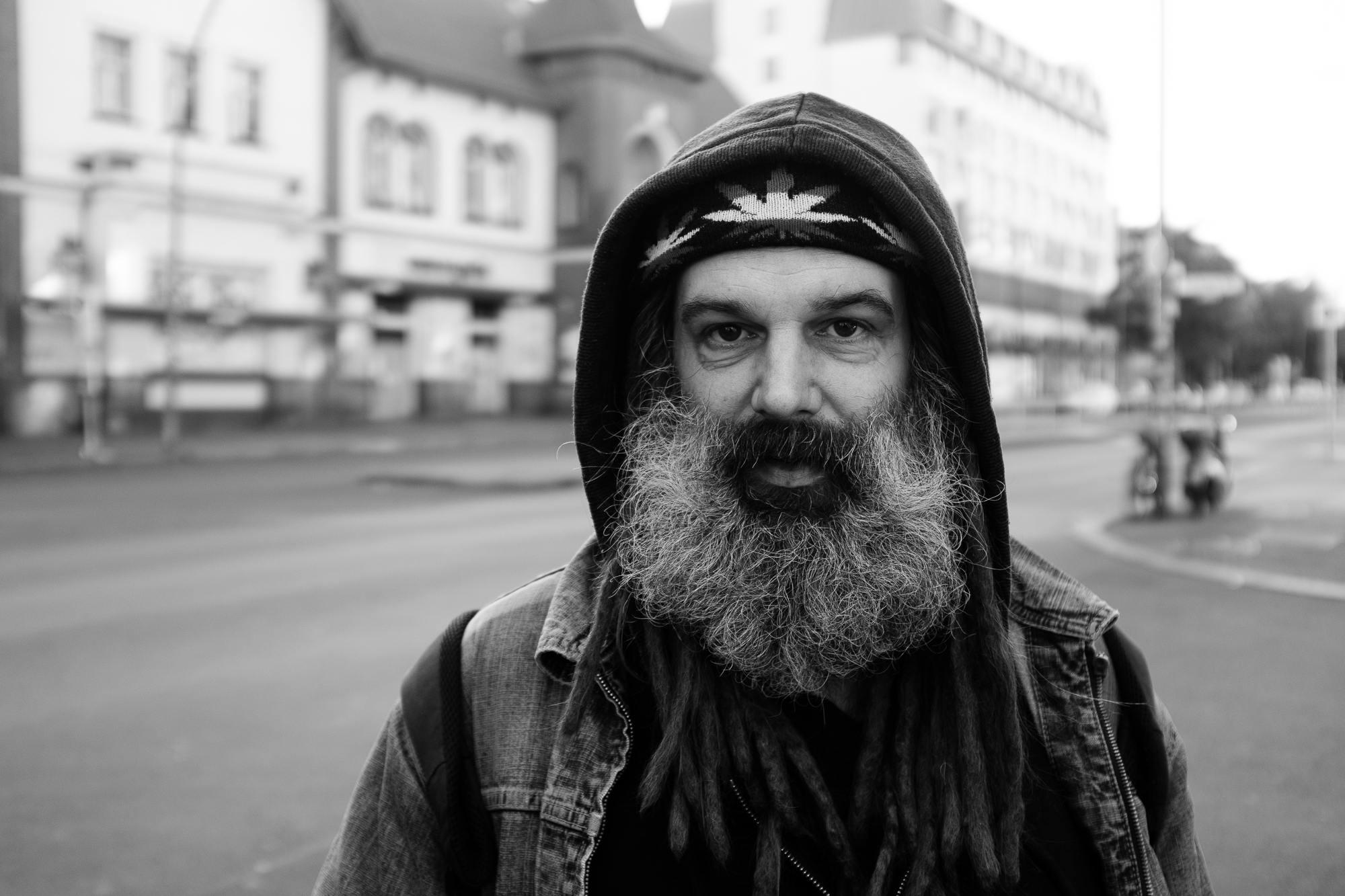 A street portrait of a bearded man with dreadlocks in Berlin Neukölln, Germany