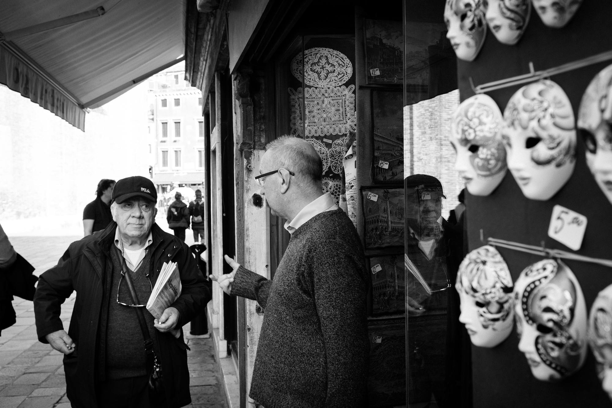 Two elderly gentleman having a conversation in Venice, Italy