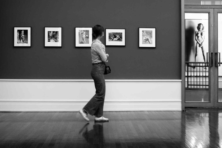 A woman looking at pictures at the Helmut Newton Foundation in Berlin, Germany