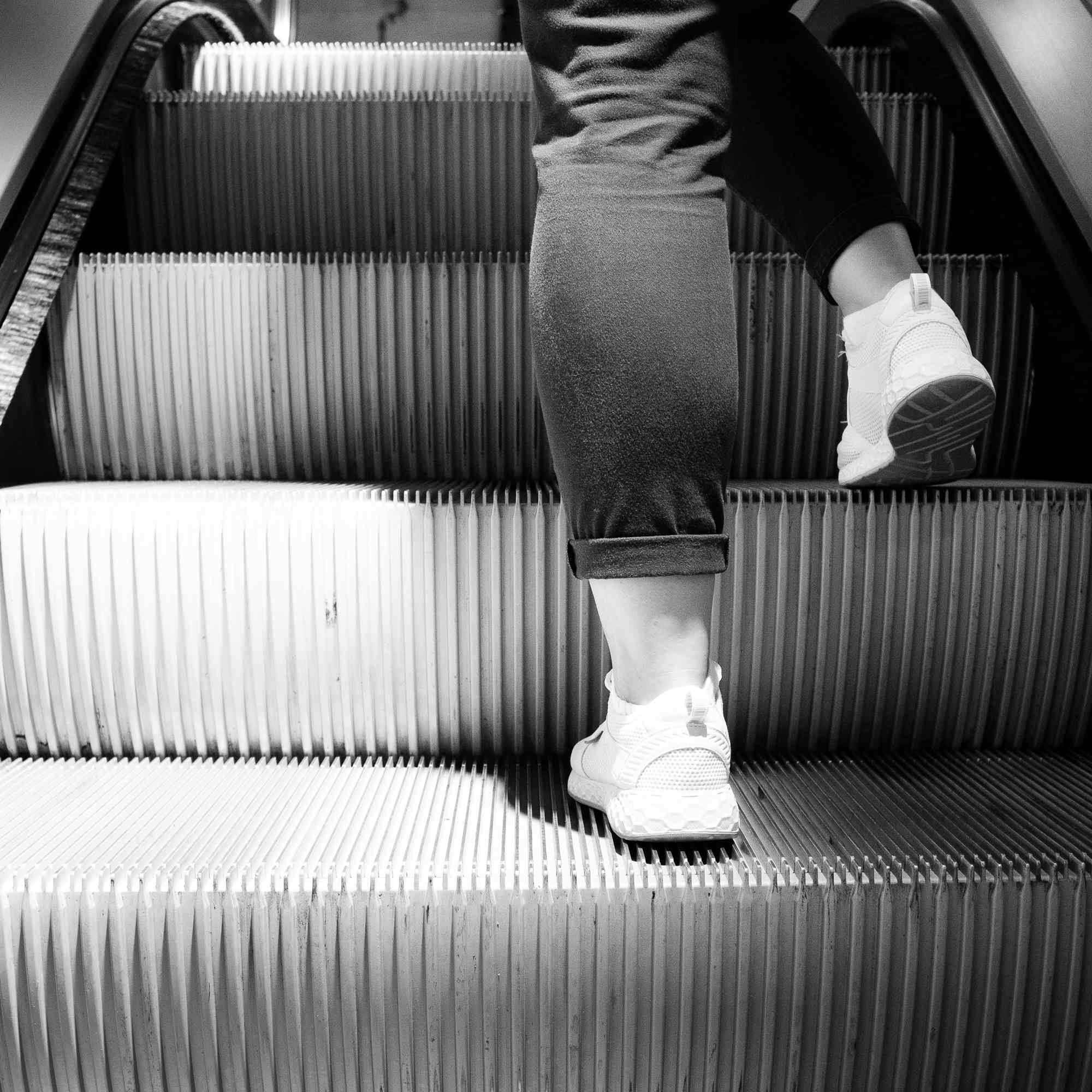 An escalator with someone's legs