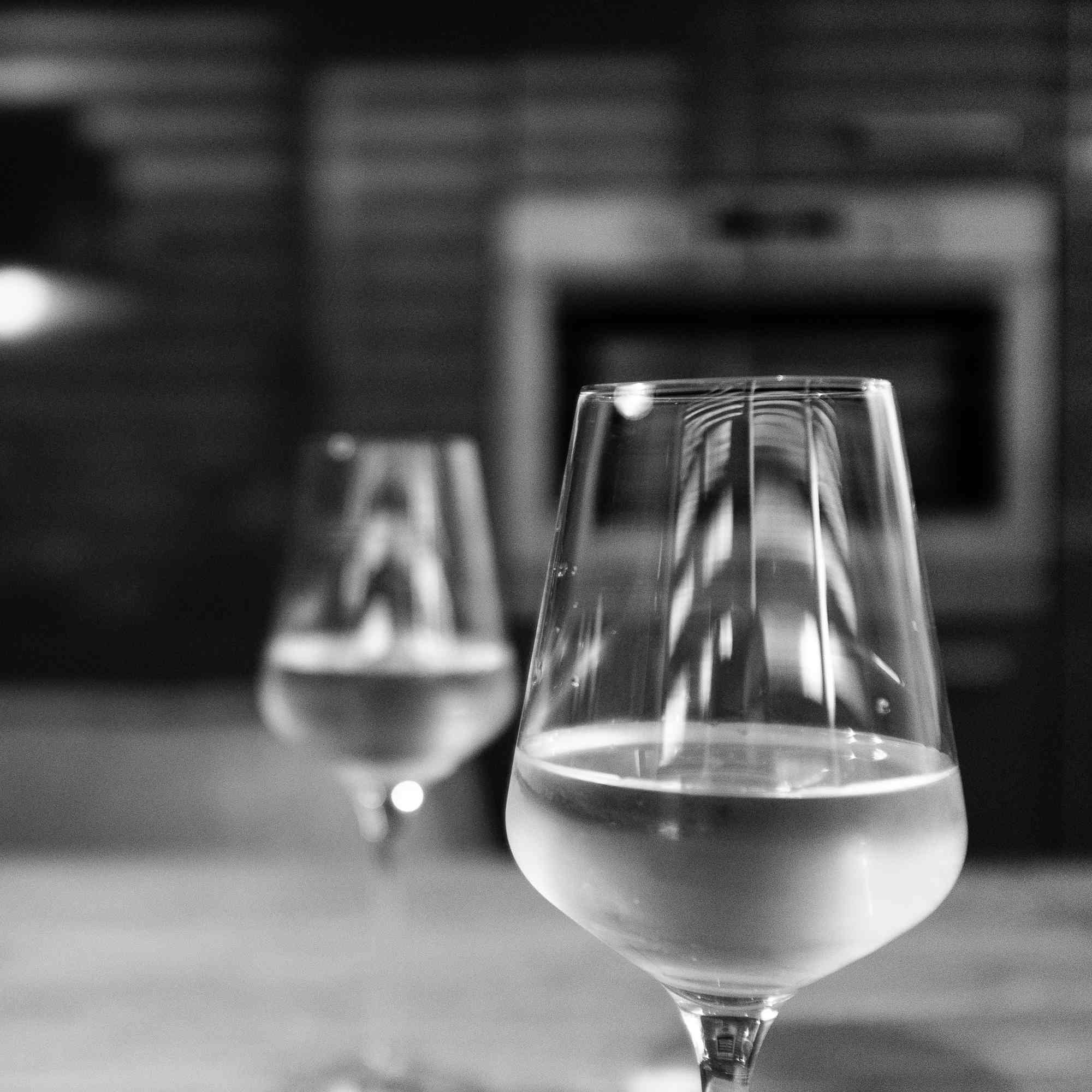 White wine glasses on table