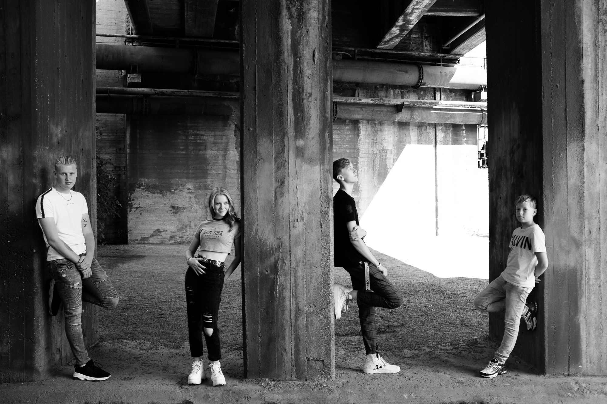 A group portrait between concrete pillars
