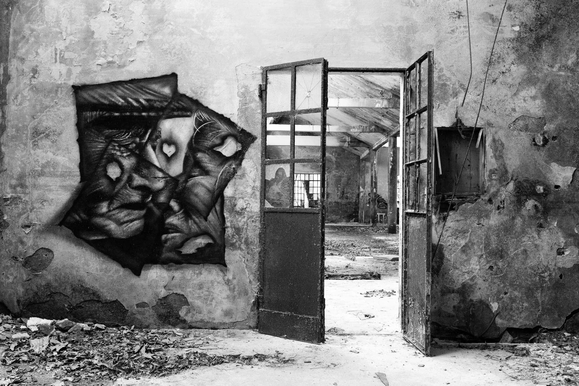 Graffiti of faces near a door