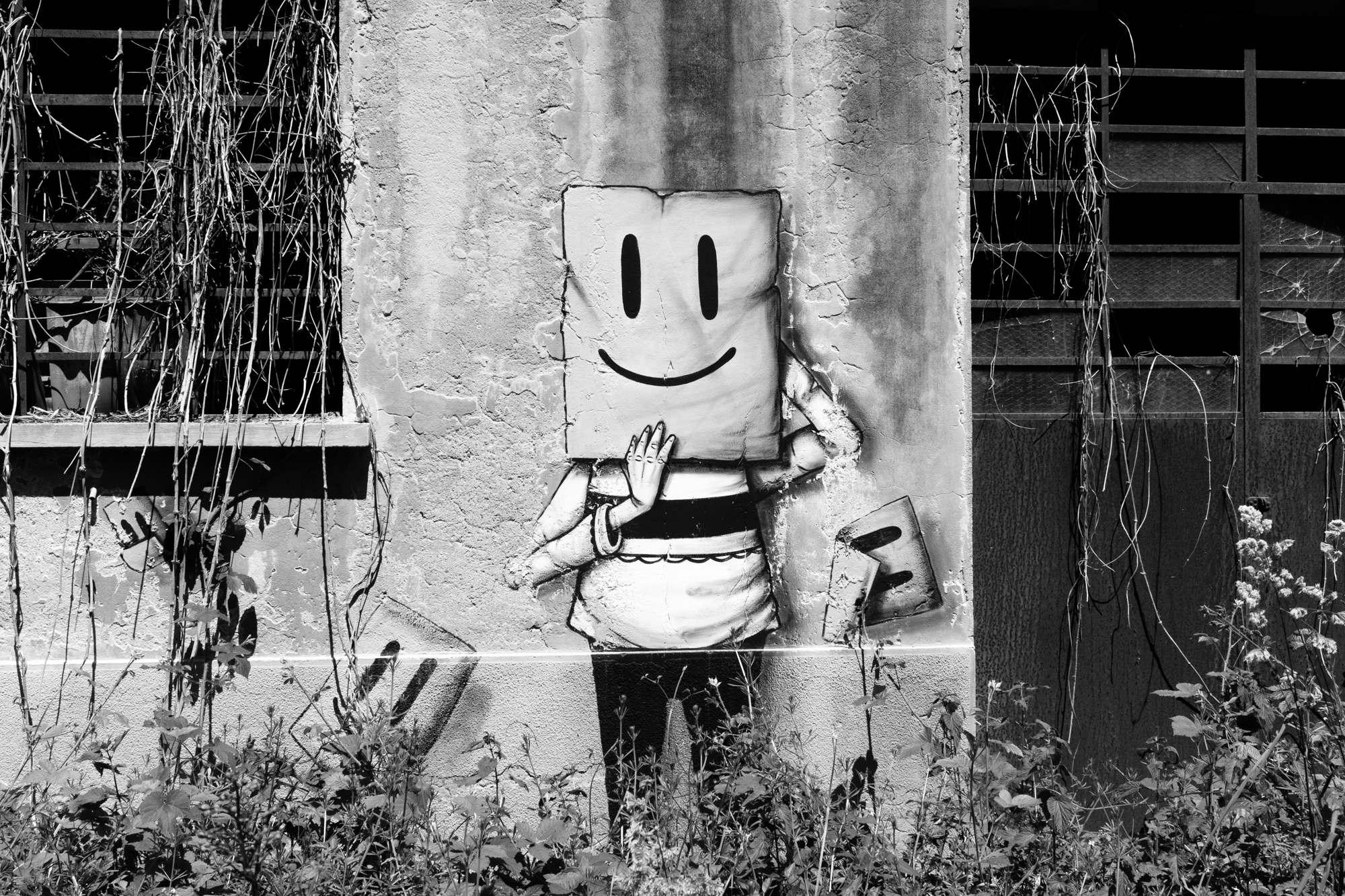 Graffiti of square smiley faces