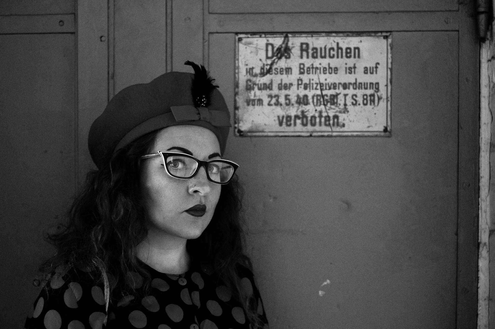 Girl in front of old No-smoking sign