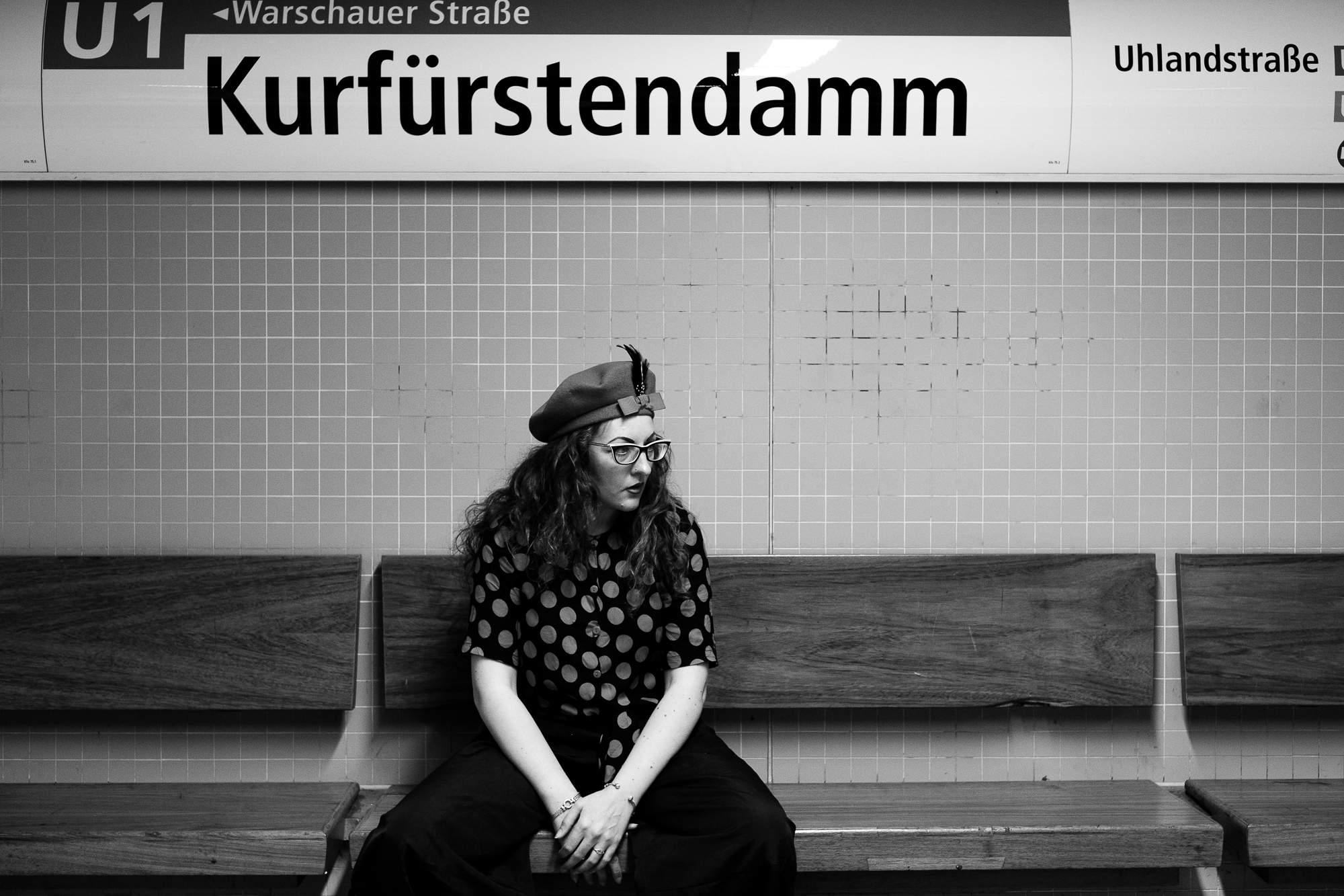 Girl sitting on subway bench Kurfuerstendamm